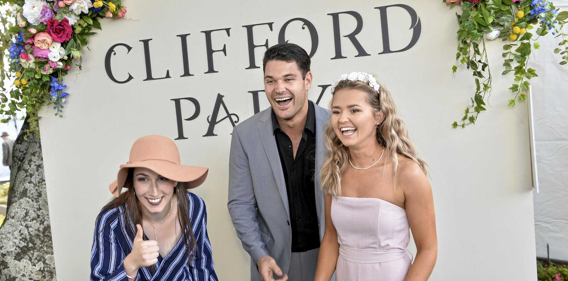 Bachelorette star Apollo Jackson plays up to the photo booth camera with Katherine Sampson (left) and Ash Cavanagh on Weetwood day at Clifford Park Racecourse.