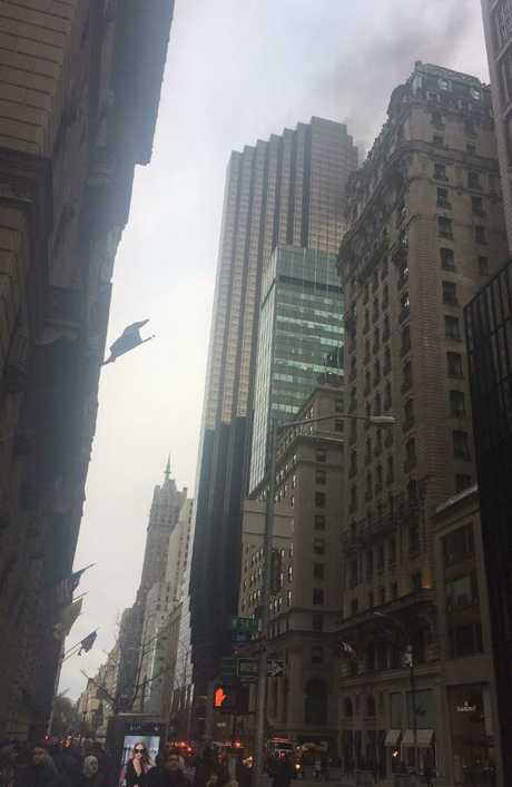 Smoke rises from the 50th floor of  the Trump Tower.