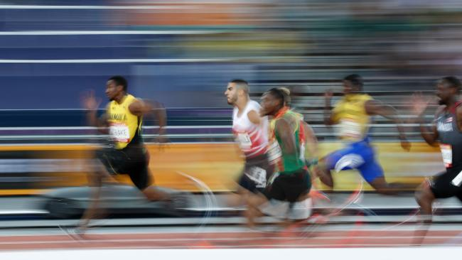 Jamaica's Yohan Blake wins his heat in the men's 100m, but he's disappointed former teammate Usain Bolt. Picture: AFP Adrian Dennis