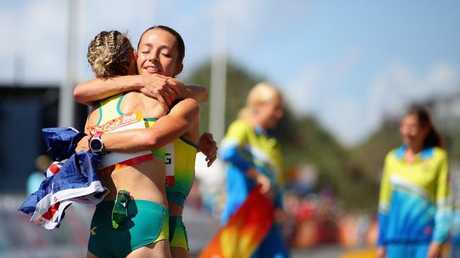 Claire Tallent embraces Jemima Montag after she won the women's 20km walk. (Photo by Scott Barbour/Getty Images)