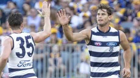 Geelong's Tom Hawkins high-fives Patrick Dangerfield as the pair helped the Cats fight back. Pic: AAP