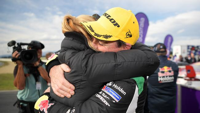An elated Craig Lowndes with wife Lara after his first race win since 2016.