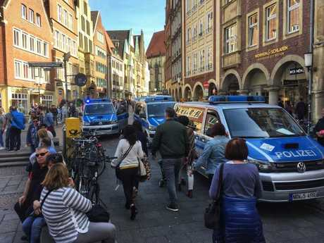 Pedestrians make their way through Muenster shortly after the attack. Picture: AP