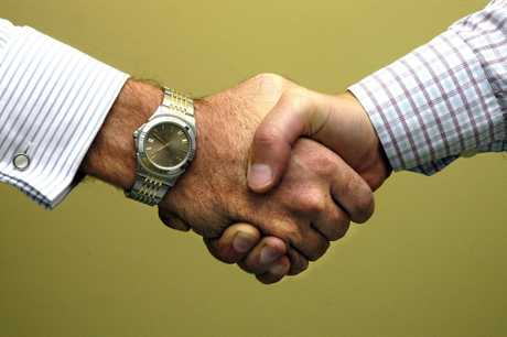 Two men shaking handsPhoto: John McCutcheon / Sunshine Coast Daily