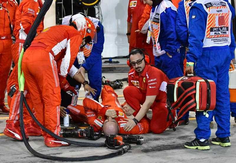A mechanic of Scuderia Ferrari lays down after he was hit by Finnish Formula One driver Kimi Raikkonen of Scuderia Ferrari during the 2018 Formula One Grand Prix of Bahrain at the Sakhir circuit near Manama, Bahrain, 08 April 2018.