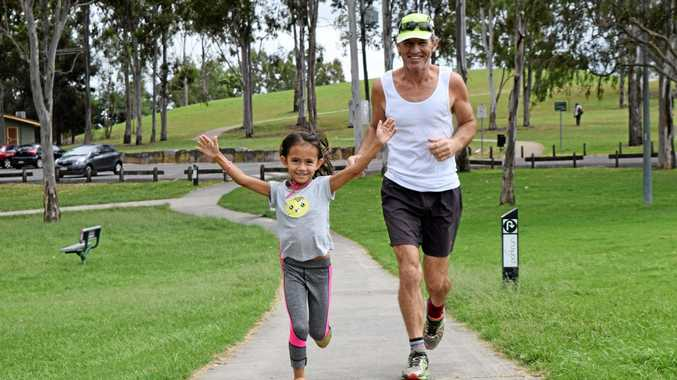 Mavis Colbert, 7, has just completed her 100th Parkrun. She is pictured with her dad Tony.