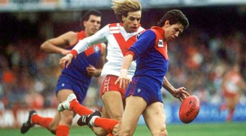STAR: Warwick Capper on the ball in his playing days.