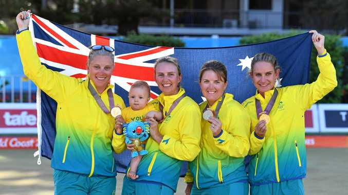 Natasha Scott, Kelsey Cottrell with her baby Sienna, Rebecca van Asch and Carla Krizanic of Australia during the medal ceremony.