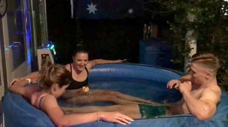 Aussie riders Georgia Baker, Rebecca Wiasak and Matthew Glaetzer in the ice bath at the team's Brisbane headquarters.
