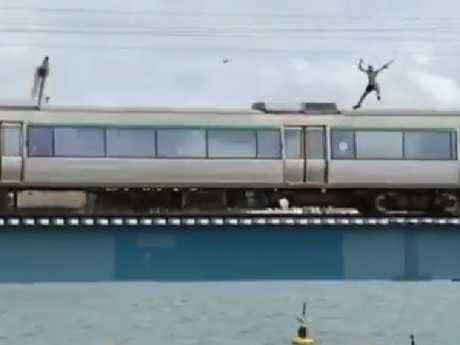 A train surfer was seen leaping from a bridge in Western Australia in a stunt that has been labelled 'stupid' and 'selfish'.