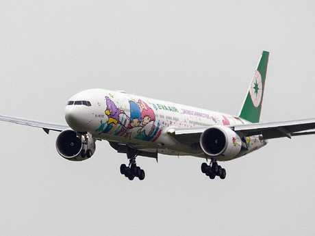 An EVA Air plane decorated with Hello Kitty livery.