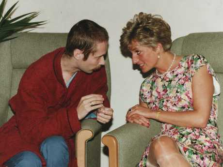Princess Diana sits in a chair chatting with Steve, 28, at a centre for AIDS / HIV+ patients at Middlesex Hospital in London. Picture: Supplied