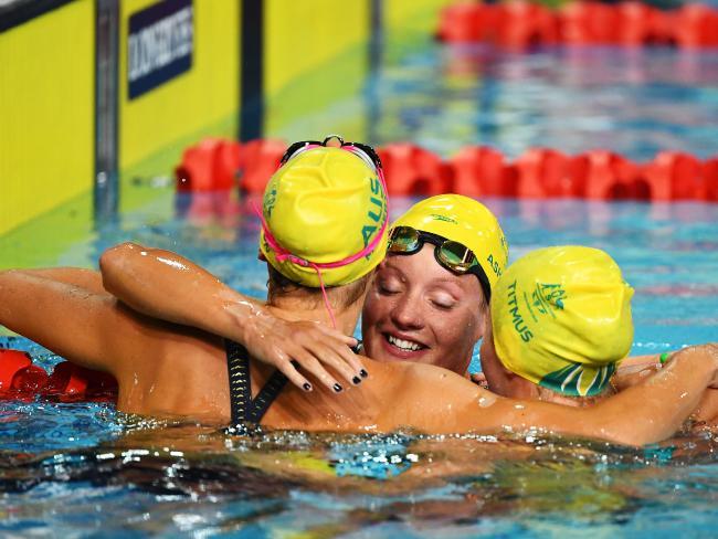 Ariarne Titmus, Jessica Ashwood and Kiah Melverton of Australia celebrate following the Women's 800m Freestyle Final