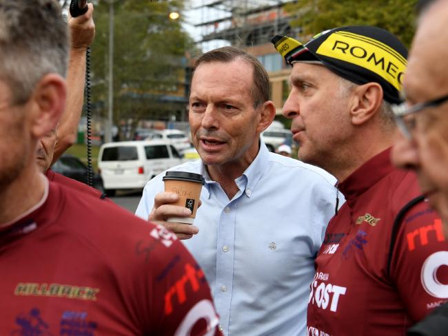 Former prime minister Tony Abbott (second left) speaks with fellow riders at Warragul before taking part in the Pollie Pedal Bike Ride today. Picture: AAP