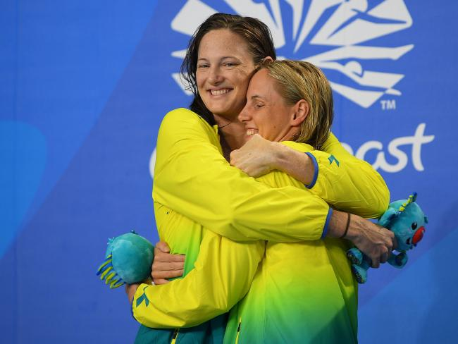 Cate Campbell (left) hugs gold medallist Bronte  after the medal ceremony. Picture: AFP/Manan Vatsyayana