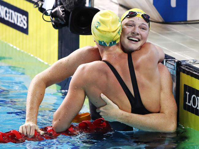 Cate Campbell congratulates sister Bronte following her upset win in the women's 100 metres freestyle. Picture: Hannah Peters/Getty Images