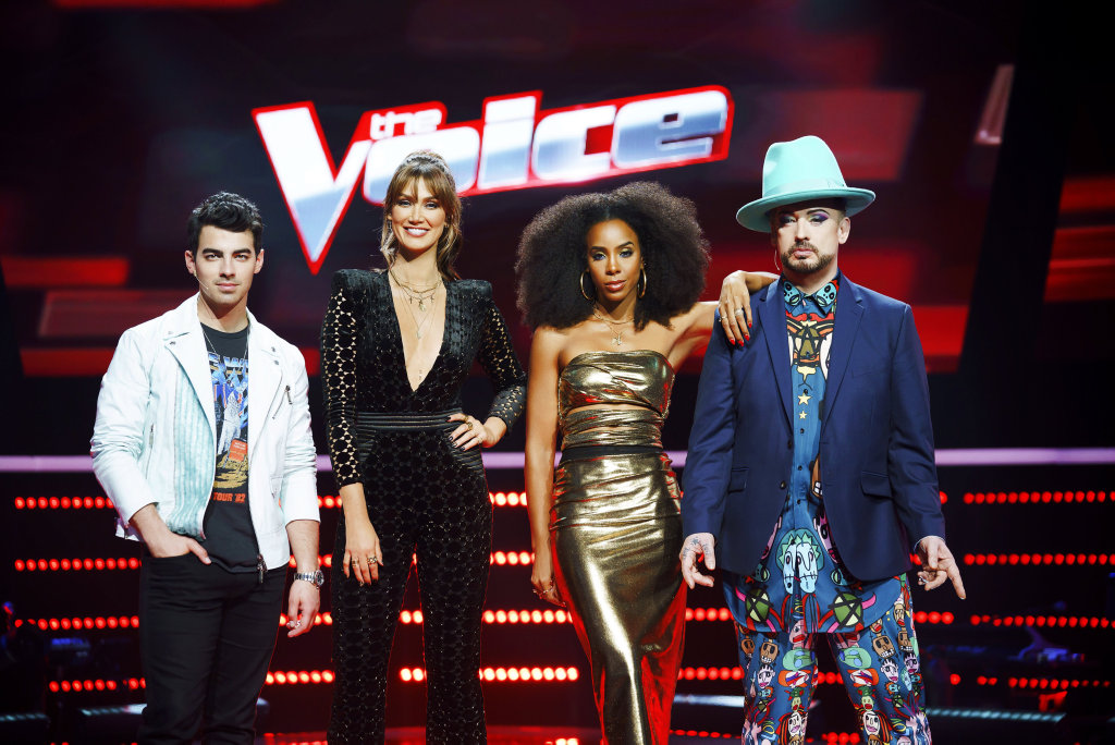 The Voice's 2018 season coaches, from left, Joe Jonas, Delta Goodrem, Kelly Rowland and Boy George.