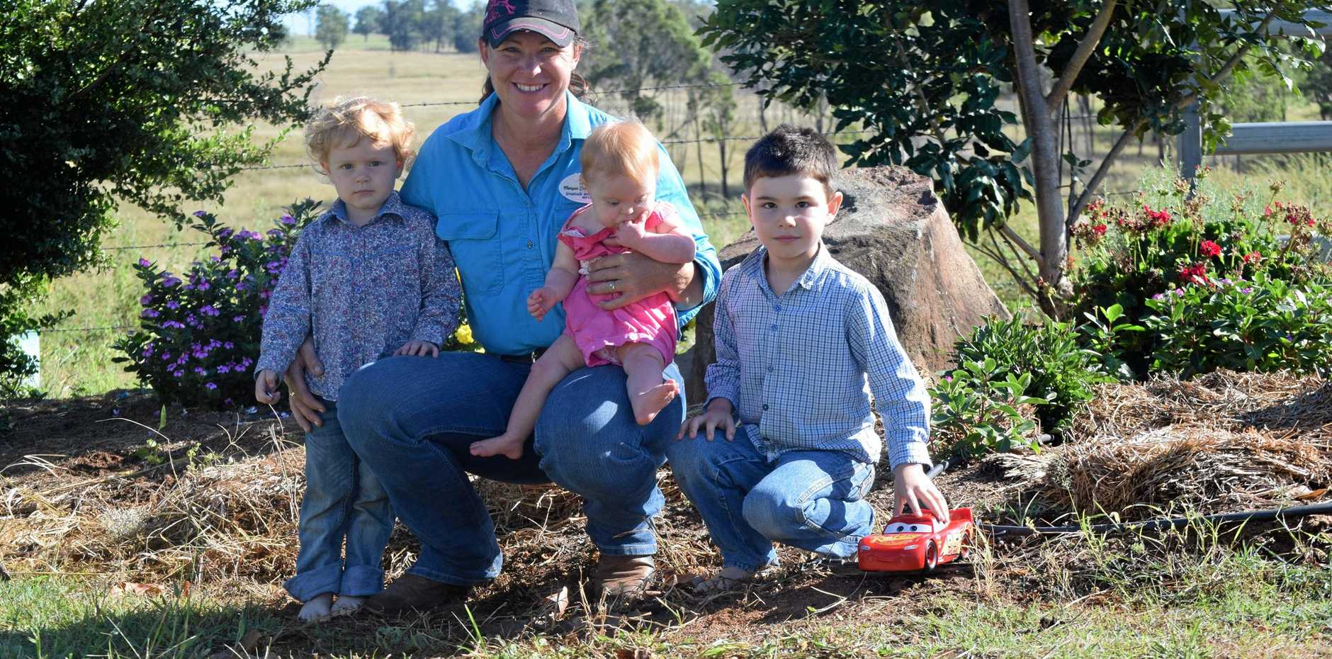 NO SERVICE: Residents are fed up in the Boynewood area over a lack of phone service. Jodi Morgan (pictured) with her three children at their rental property.