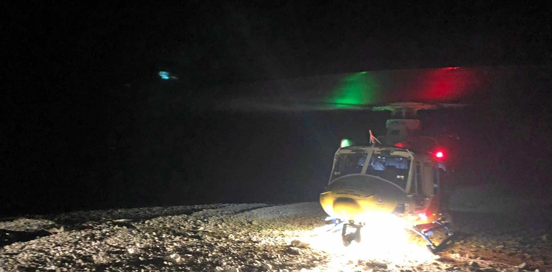 RACQ Rescue chopper transporting snake bite victim to Mackay Base Hospital last night.