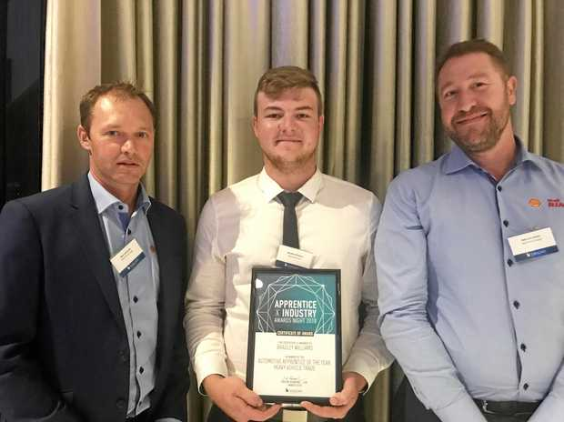 MAKING HIS MARK: Bradley Williams, of Winslow Constructors, wins Shell Rimula Apprentice of the Year award (centre). Viva Energy's Nick Lubransky (left) and Rob Cavicchiolo (right).