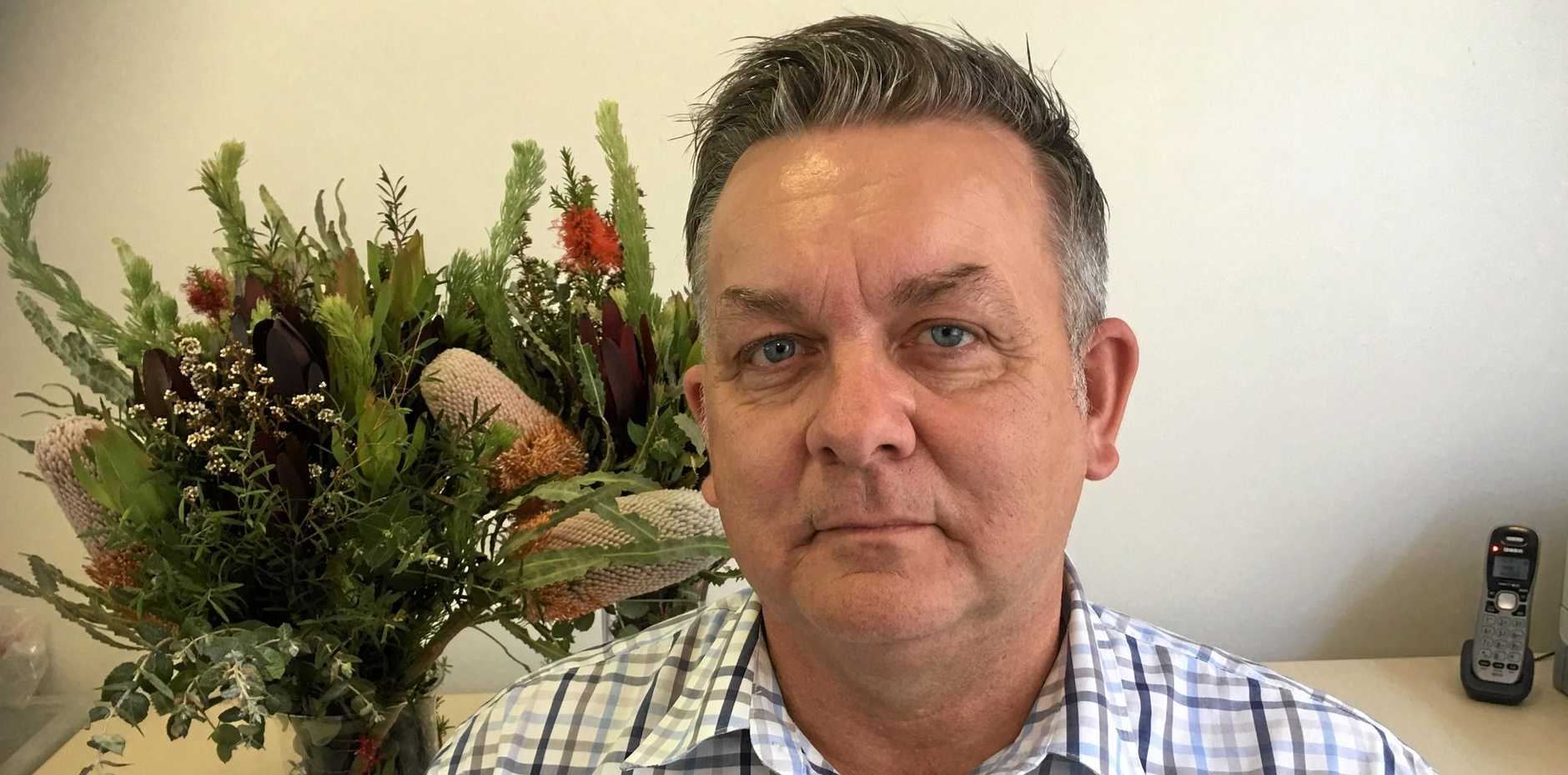 BLOOMING MAD: Flower Association executive officer Shane Holborn is upset no flowers were given at the Commonwealth Games.