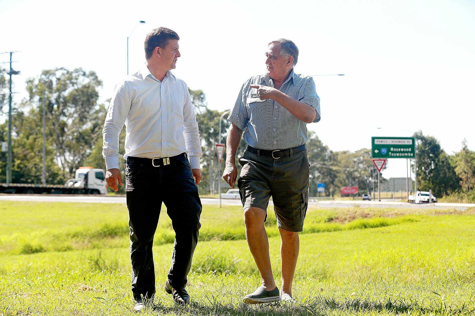 PROTECT US: Scenic Rim MP Jon Krause and George Hatchman from the Willowbank Area Residents' Group call for the State Government to expand planning changes to protect residents in Ipswich's western areas.