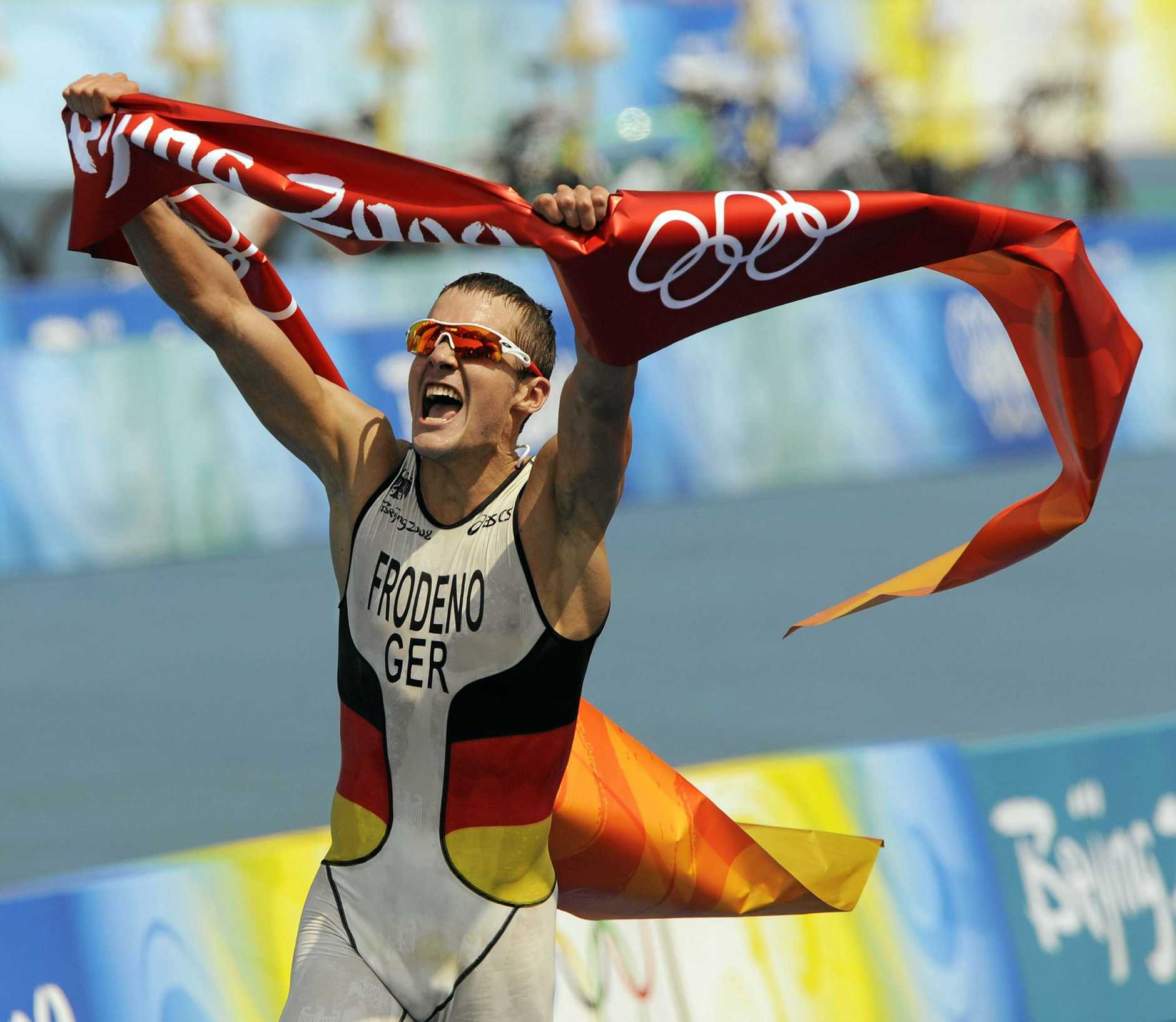 Jan Frodeno celebrates winning gold at the Beijing Olympics in 2008.