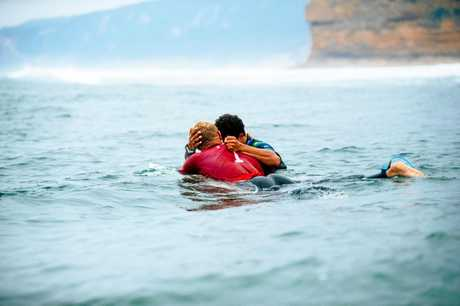 MASTER AND APPRENTICE: Triple World Champion Mick Fanning and Italo Ferreira of Brazil embrace after the final of the 2018 Rip Curl Pro Bells Beach at Bells Beach.