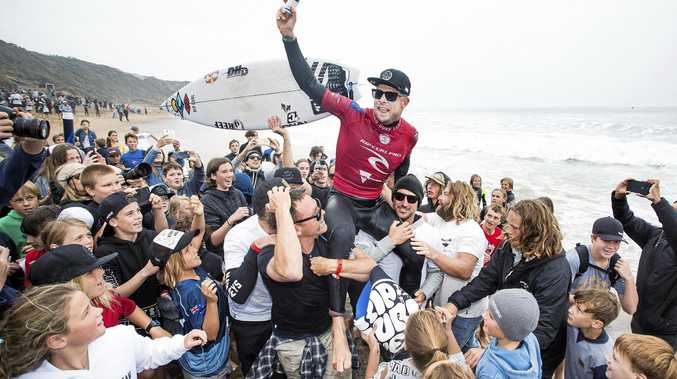 FINAL SALUTE: Adoring crowds show their appreciation for Mick Fanning - whose final act as a professional surfer was a testament to his skill, grit and humility - after he finished second at the Rip Curl Pro Bells Beach.