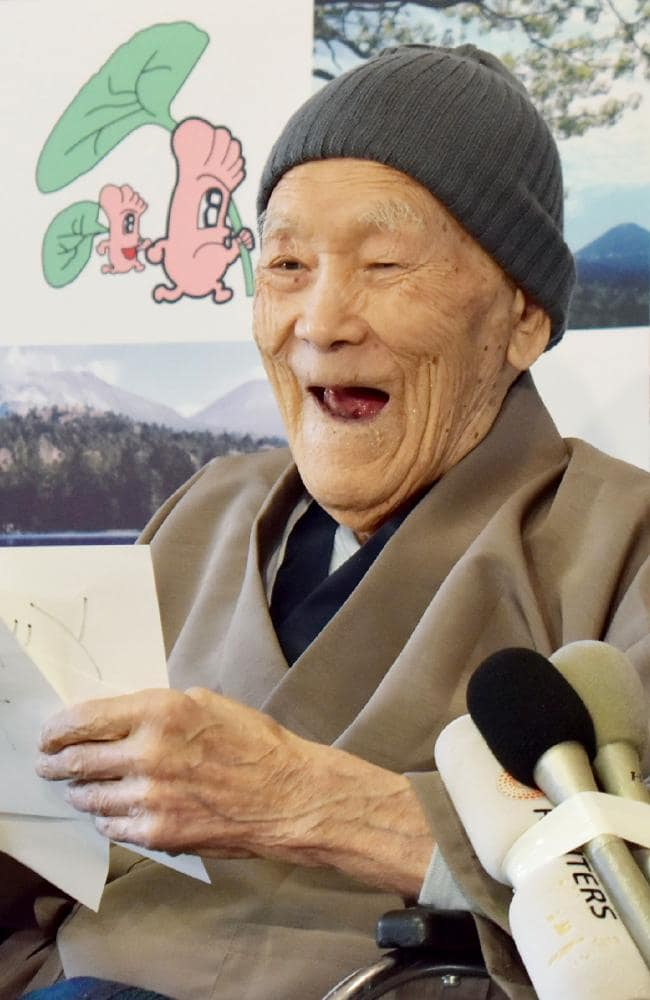 Masazo Nonaka of Japan, aged 112, smiles after being awarded the Guinness World Records' oldest male person living title. Naturally he celebrated with cake. Picture: AFP/Jiji Press