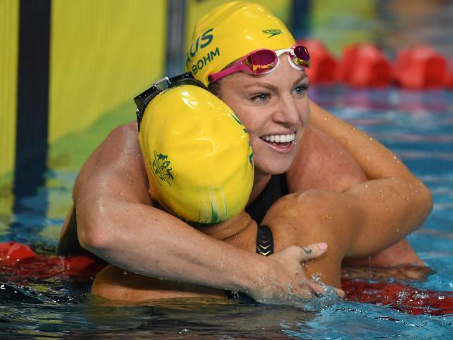 Australia 's Emily Seebohm celebrates after winning the swimming women's 50m backstroke