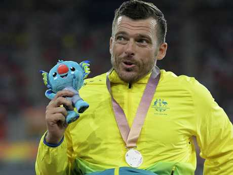 Kurt Fearnley of Australia smiles after being presented the silver medal