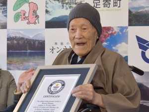 Hot springs, sweets, sumo: The secrets of world's oldest man