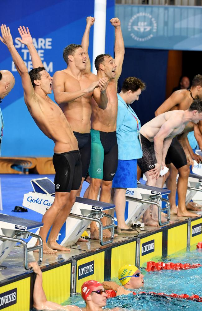 Kyle Chalmers of Australia (pool) celebrates with his team mates after winning the Mens 4x100m Medley Relay