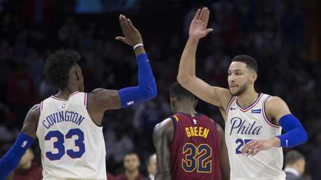 Robert Covington and Ben Simmons celebrate a win over the Cavs.