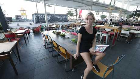 Mercedes Frenger 31 assistant manager of Gringo Loco Cantina... with her empty restaurant and bar which is in the prime position on the beach at the end of Cavill Avenue. Mercedes says the Games killed Easter for them