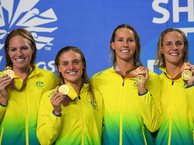 Australia's (gold) Bronte Campbell Emily Seebohm, Georgia Bohl and Emma Mckeon pose with their medals