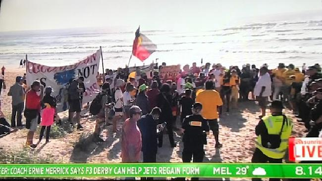 Protesters descend upon the set of Sunrise on the Gold Coast.