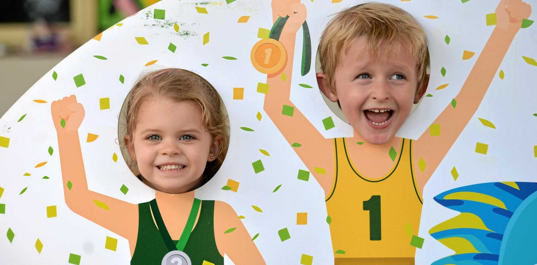 Shelby Anderson and Zane John, from Goodstart Andergrove, get into the Commonwealth Games spirit.