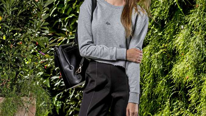 Aje crop sweater in grey marle, $195; SABA Celine pants, $199; Seed sneakers, $69.95; and Chloe Faye medium backpack, $3220.