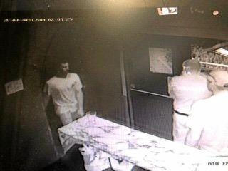 CCTV from the Rolling Rock shows a man in a grey shirt, who is believed to have been involved in an assault.