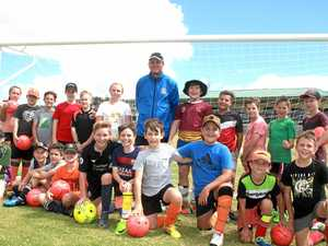 Pro footballer takes next generation under his wing