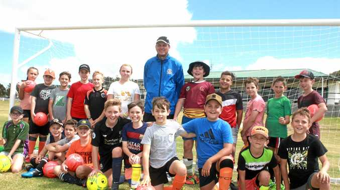 SAMBA STYLE: Thiago Kosloski with some junior Stanthorpe footballers. The Brazilian youth coach helped run some clinics over the school holidays.