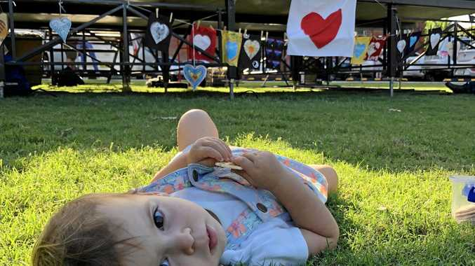 WHAT FLOOD! Frida Carnavas had only just been born when Cyclone Debbie hit last year and inundated her city. One Year On she spends are relaxed celebratory afternoon in The Quad with her community.