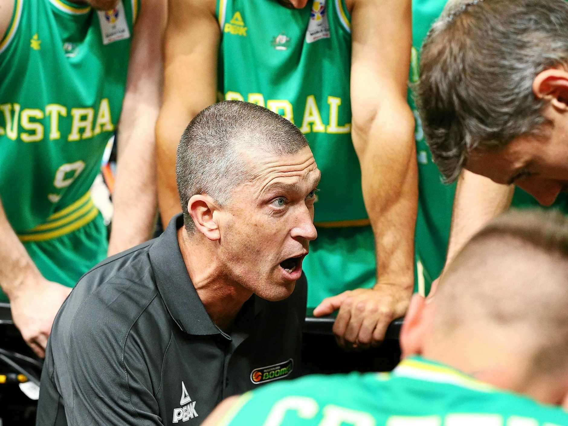 Boomers head coach Andrej Lemanis talks to his players.