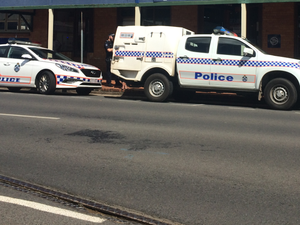 Man charged over alleged flashing in CBD store