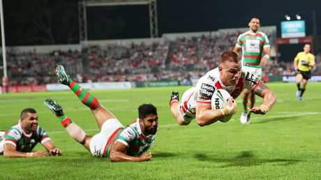 Euan Aitken scores a try leading Greg Inglis in his wake. Picture: Brett Costello