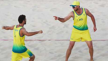 Australia's Damien Schumann (left) and Christopher McHugh celebrate winning a point in their semi-final against England.