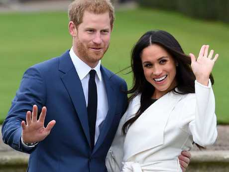 Prince Harry and Meghan Markle pose for the media at Kensington Palace after announcing their engagement. Picture: Eddie Mulholland/Pool via AP