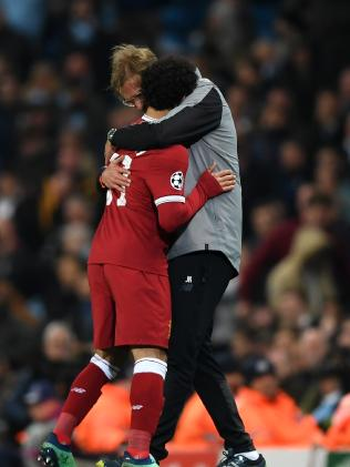 Mohamed Salah of Liverpool embraces Jurgen Klopp